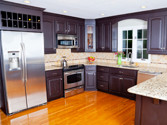 Kitchen with new appliances that's protected by a home systems & appliance warranty.