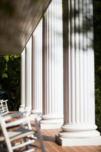 Tall white pillars on front porch of home.